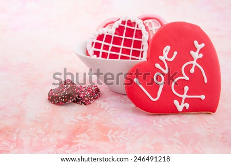 Valentine's Day cookies on a soft pink background - stock photo