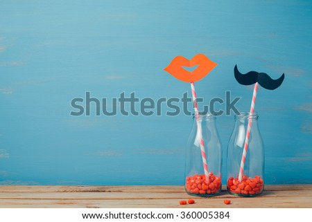 Valentine's day creative romantic background with retro bottles and straws - stock photo