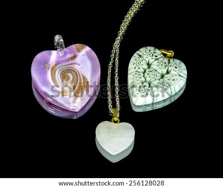 valentine's day heart shaped pendants - stock photo