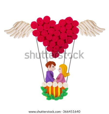 Valentine's Day heart with wings out of plasticine. Isolated on White Background. - stock photo