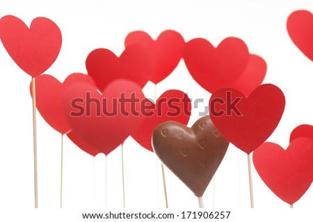 Valentine's day hearts on a stick with chocolate heart isolated on light background