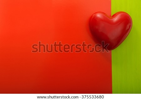 Valentine's day. Holiday Card. Red heart on a red and green background - stock photo