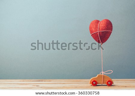 Valentine's day holiday celebration with toy car and heart shape - stock photo