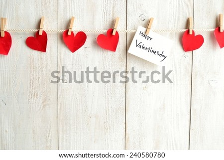 Valentine's day message card with red heart paper cut out - stock photo