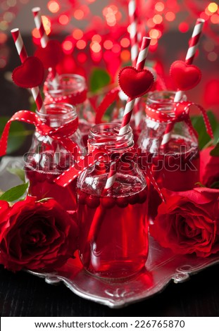 Valentine's Day party idea:individual small bottles with cranberry cocktail - stock photo