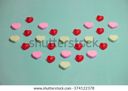 Valentine's Day Red Gummy and  Hearts on Green Background