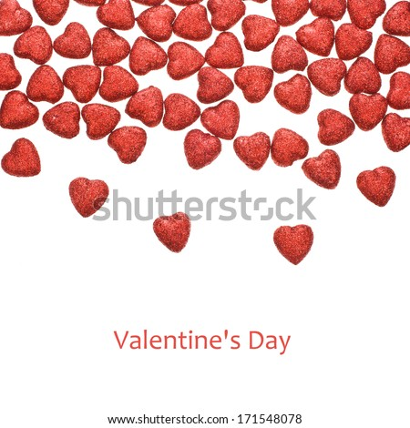 Valentine's Day -  small glittering figure in the shape of heart scattered isolated on white background - stock photo
