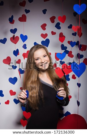 Valentine's Day. smiling woman with a gift in the form of heart - stock photo