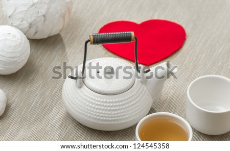 Valentine's day surprise for couple. Romantic tea set with red heart