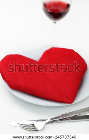 Valentine's day table setting with heart-shaped napkin