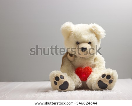 Valentine's Day.Teddy bear with red heart - stock photo