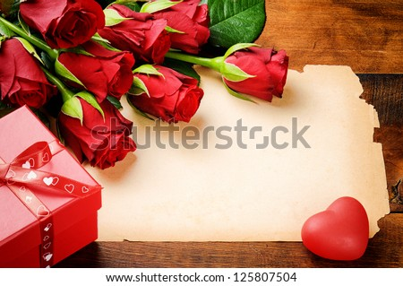 Valentine's frame with red roses and vintage paper - stock photo