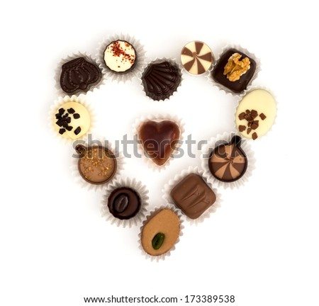 Valentine's heart made of delicious chocolate pralines. - stock photo
