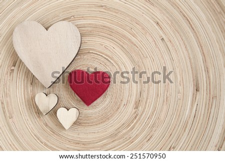 valentine's wooden hearts on a wooden background , valentine's day, day valentine postcard with space for text - stock photo