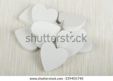 valentine's wooden hearts on white fabric , valentine's day, day valentine postcard with space for text