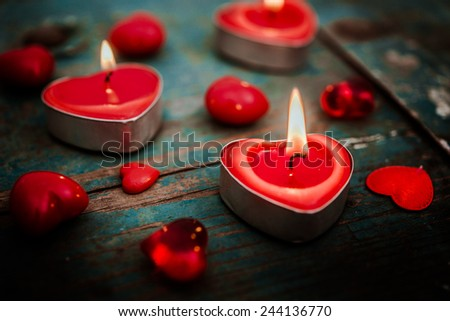 valentines candle on wooden background - stock photo