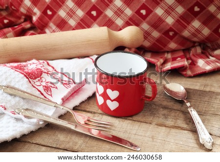 Valentines concept with hearts mug and kitchen utensils - stock photo
