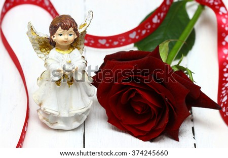 Valentines Day. Angel and rose - stock photo