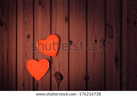 Valentines Day background, two hearts on wooden texture - stock photo