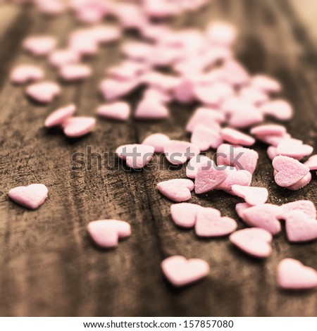 Valentines Day background with candy hearts. Sugar Hearts on wooden vintage textured background or table. - stock photo