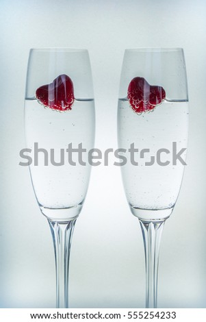 Valentines day background with champagne glasses and red hearts