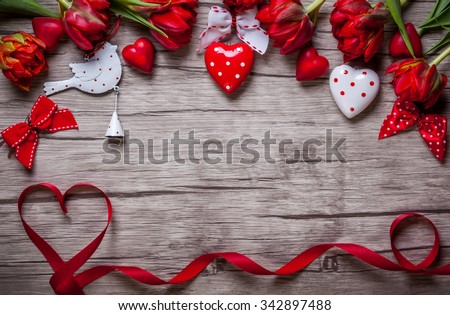 Valentines Day background with chocolates, hearts and red tulips - stock photo