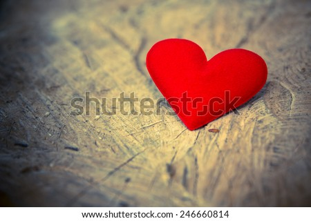 Valentines Day background with Fabric valentine heart on grunge wood table. Retro filter. - stock photo