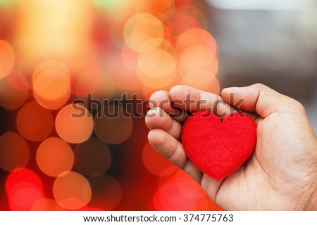 Valentines Day background with hand hold heart