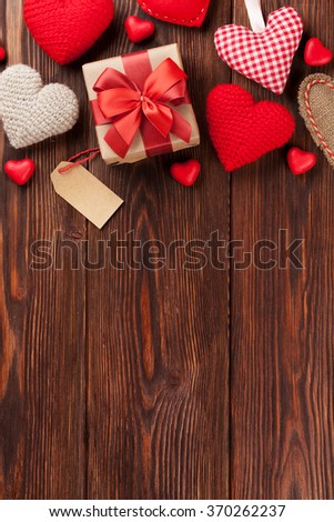 Valentines day background with handmaded hearts and candies over wood. Top view with copy space