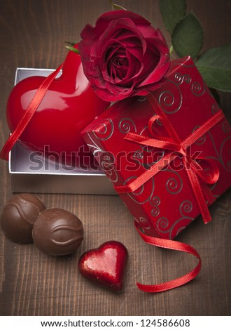 Valentines Day background with hearts, present, rose and chocolate