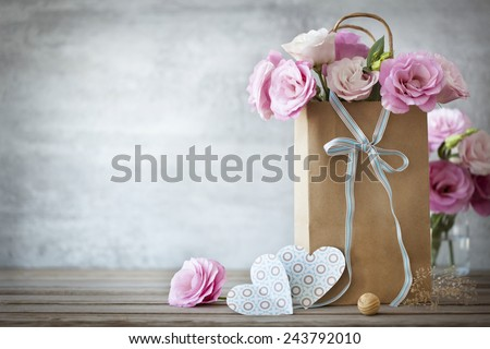 Valentines Day background with pink roses, bow and paper Hearts - stock photo
