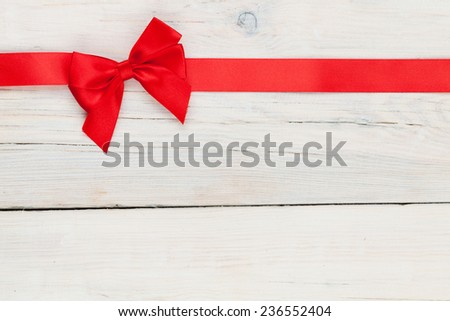 Valentines day background with red ribbon over wood - stock photo