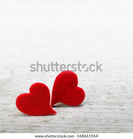 valentines day background with two hearts on wooden background - stock photo