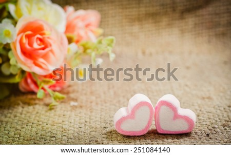 Valentines Day background with two pinks hearts and rose flower on vintage retro background. - stock photo