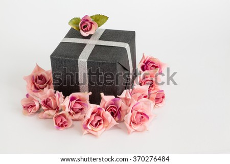 Valentines Day, black gift box with roses on white background.  - stock photo