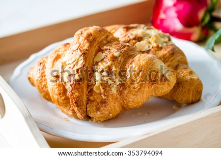 Valentines day breakfast - delicious fresh croissants with coffee and rose - stock photo