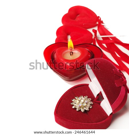 Valentines Day.Burning candle and gift.