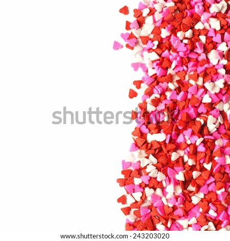 Valentines Day candy heart border of red, white and pink sprinkles - stock photo