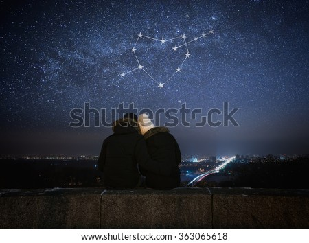 Valentines Day card. Couple in love looking at stars. Night in city. Constellation in shape of a heart - stock photo