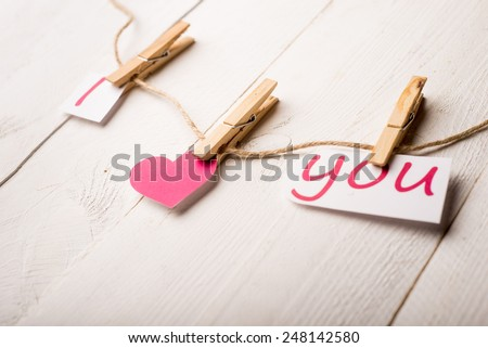 Valentines day card with hearts and words of love on old wood background - stock photo
