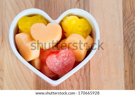 Valentines Day child friendly healthy treat with heart-shaped fruit cantaloupe, watermelon and pineapple - stock photo