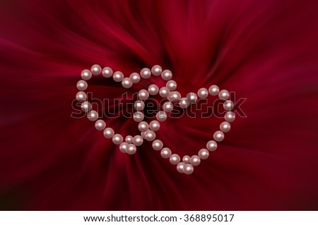 Valentines Day compositions with pearls and hearts on a deep burgundy background