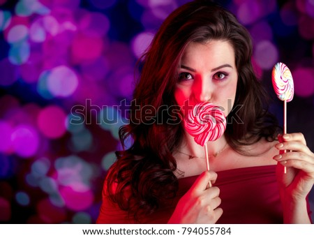 Valentines day concept. Pretty girl on bokeh background.