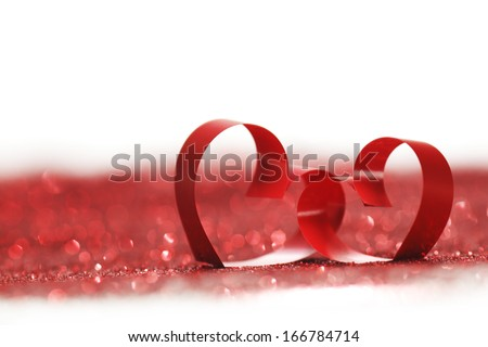 Valentines day decorative hearts on red glitter background - stock photo