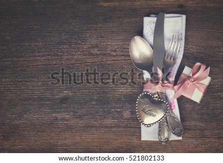 Valentines day dinner with vintage cutlery and gift box, retro toned