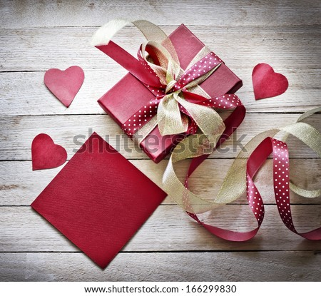 Valentines Day gift, hearts and greeting card on wooden plates in vintage style - stock photo