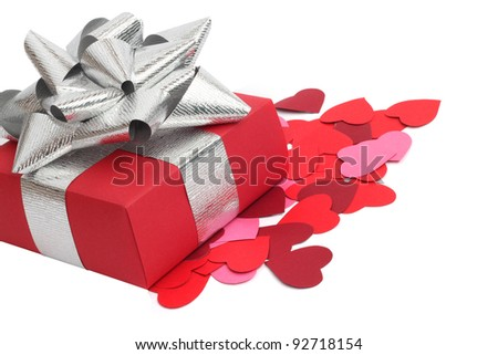 Valentines Day gift in red box and small hearts isolated on white
