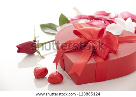 Valentines Day gift in red box with rose petal  isolated on white - stock photo