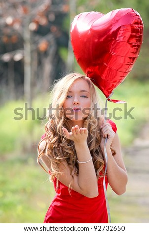 Valentines day girl with heart balloons