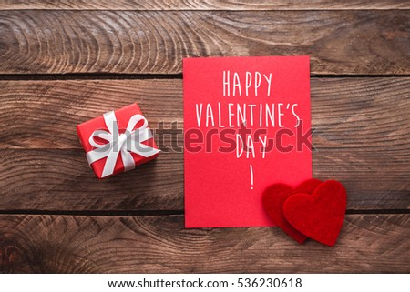 Happy valentines day card gift box stock photo 577746850 valentines day greeting card and small gift heart decoration over wooden background valentines greetings negle Gallery